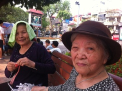Old dears at Hoan Kiem lake knitting with plastic
